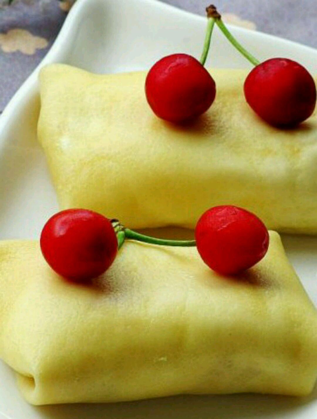 融化黄油10g 淡奶油200g 芒果2个 芒果班戟--港式甜品的做法步骤 15.